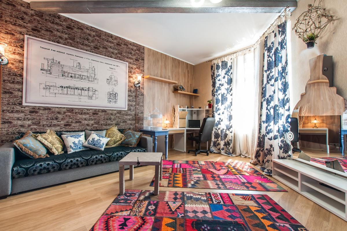 Ковры в интерьере гостиной: современный подход к выбору ковровых изделий